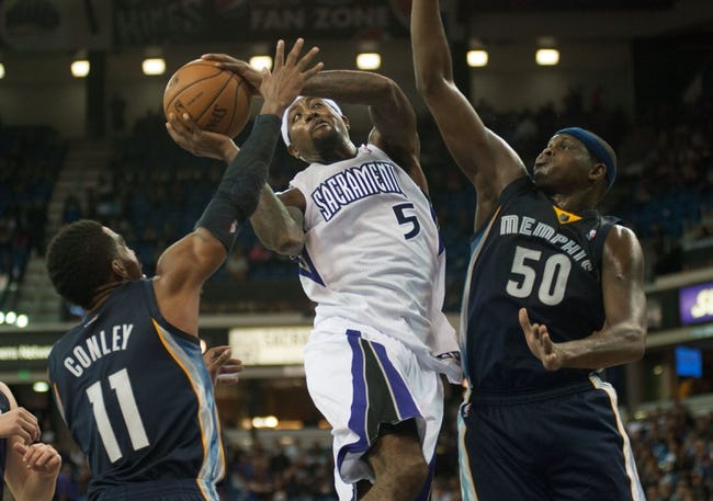 Nov 17, 2013; Sacramento, CA, USA; Sacramento Kings small forward John Salmons (5) drives to the basket against Memphis Grizzlies point guard Mike Conley (11) and power forward Zach Randolph (50) during the fourth quarter at Sleep Train Arena.  The Memphis Grizzlies defeated the Sacramento Kings 97-86. Mandatory Credit: Ed Szczepanski-USA TODAY Sports