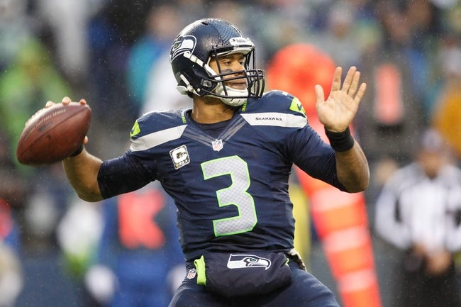 Nov 17, 2013; Seattle, WA, USA; Seattle Seahawks quarterback Russell Wilson (3) passes against the Minnesota Vikings during the second half at CenturyLink Field. Mandatory Credit: Joe Nicholson-USA TODAY Sports