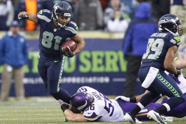 Nov 17, 2013; Seattle, WA, USA; Seattle Seahawks wide receiver Golden Tate (81) is tackled by Minnesota Vikings inside linebacker Michael Mauti (56) after returning a punt during the third quarter at CenturyLink Field. Mandatory Credit: Joe Nicholson-USA TODAY Sports