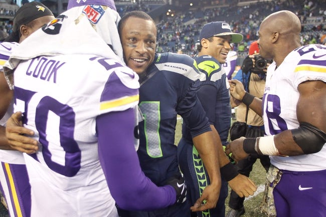 Nov 17, 2013; Seattle, WA, USA; Seattle Seahawks wide receiver Percy Harvin (11) greets Minnesota Vikings cornerback Chris Cook (20) following a 41-20 Seattle victory at CenturyLink Field. Mandatory Credit: Joe Nicholson-USA TODAY Sports