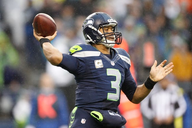 Nov 17, 2013; Seattle, WA, USA; Seattle Seahawks quarterback Russell Wilson (3) passes against the Minnesota Vikings during the third quarter at CenturyLink Field. Mandatory Credit: Joe Nicholson-USA TODAY Sports