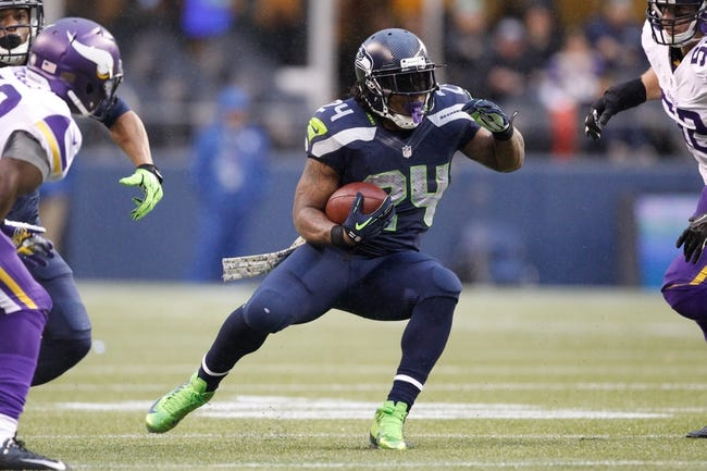 Nov 17, 2013; Seattle, WA, USA; Seattle Seahawks running back Marshawn Lynch (24) rushes against the Minnesota Vikings during the third quarter at CenturyLink Field. Mandatory Credit: Joe Nicholson-USA TODAY Sports