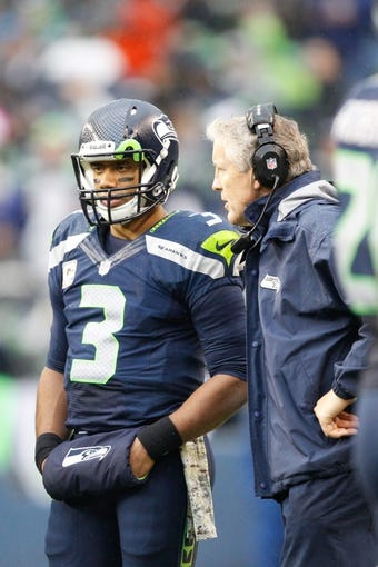 Nov 17, 2013; Seattle, WA, USA; Seattle Seahawks head coach Pete Carroll speaks with Seattle Seahawks quarterback Russell Wilson (3) during a third quarter timeout against the Minnesota Vikings at CenturyLink Field. Mandatory Credit: Joe Nicholson-USA TODAY Sports