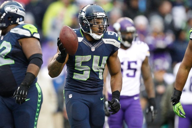 Nov 17, 2013; Seattle, WA, USA; Seattle Seahawks middle linebacker Bobby Wagner (54) comes back to the sideline after making an interception against the Minnesota Vikings during the fourth quarter at CenturyLink Field. Mandatory Credit: Joe Nicholson-USA TODAY Sports