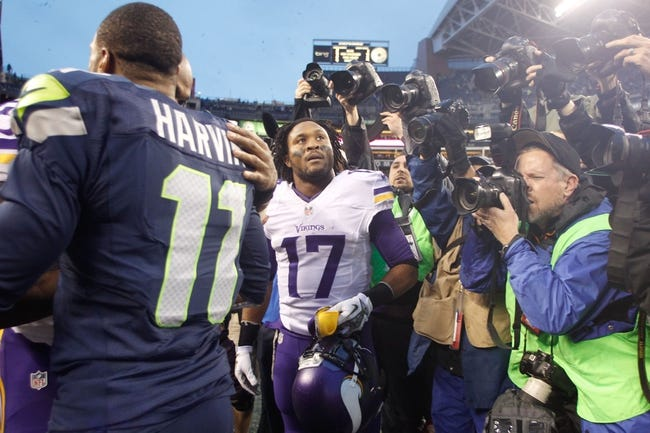 Nov 17, 2013; Seattle, WA, USA; Minnesota Vikings wide receiver Jarius Wright (17) waits to talk with former teammate Seattle Seahawks wide receiver Percy Harvin (11) following a 41-20 Seattle victory at CenturyLink Field. Mandatory Credit: Joe Nicholson-USA TODAY Sports