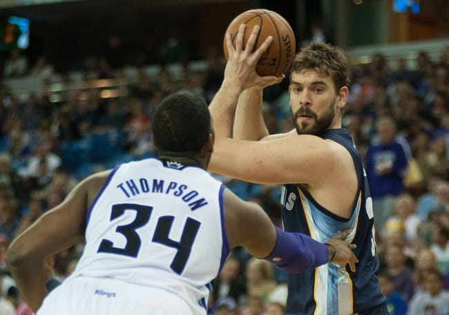 Nov 17, 2013; Sacramento, CA, USA; Sacramento Kings power forward Jason Thompson (34) defends against Memphis Grizzlies center Marc Gasol (33) during the first quarter at Sleep Train Arena. The Memphis Grizzlies defeated the Sacramento Kings 97-86. Mandatory Credit: Ed Szczepanski-USA TODAY Sports