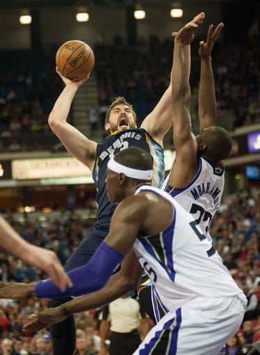 Nov 17, 2013; Sacramento, CA, USA; Memphis Grizzlies center Marc Gasol (33) takes a shot over Sacramento Kings power forward Luc Richard Mbah a Moute (33) during the second quarter at Sleep Train Arena. The Memphis Grizzlies defeated the Sacramento Kings 97-86. Mandatory Credit: Ed Szczepanski-USA TODAY Sports