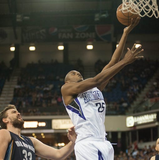 Nov 17, 2013; Sacramento, CA, USA; Sacramento Kings small forward Travis Outlaw (25) takes a shot against Memphis Grizzlies center Marc Gasol (33) during the third quarter at Sleep Train Arena. The Memphis Grizzlies defeated the Sacramento Kings 97-86. Mandatory Credit: Ed Szczepanski-USA TODAY Sports