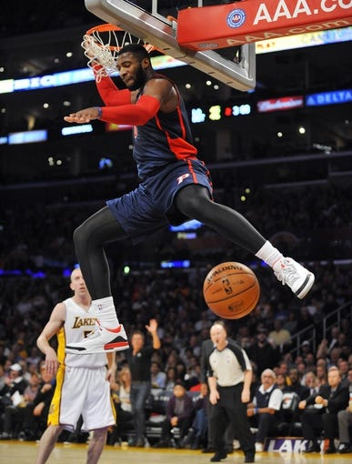 November 17, 2013; Los Angeles, CA, USA; Detroit Pistons center Andre Drummond (0) dunks to score a basket against the Los Angeles Lakers during the first half at Staples Center. Mandatory Credit: Gary A. Vasquez-USA TODAY Sports