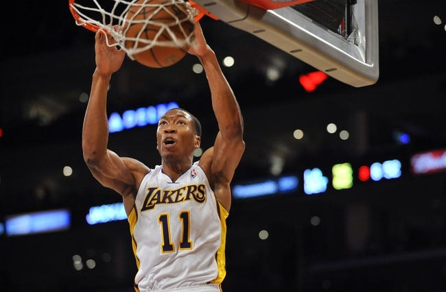 November 17, 2013; Los Angeles, CA, USA; Los Angeles Lakers shooting guard Wesley Johnson (11) dunks to score a basket against the Detroit Pistons during the second half at Staples Center. Mandatory Credit: Gary A. Vasquez-USA TODAY Sports