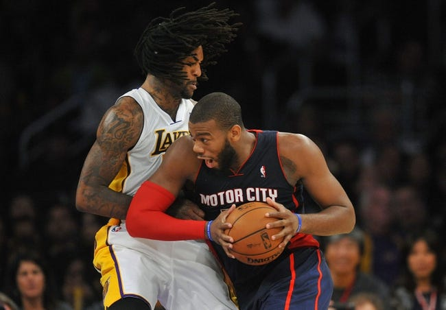 November 17, 2013; Los Angeles, CA, USA; Detroit Pistons power forward Greg Monroe (10) moves the ball against the defense of Los Angeles Lakers center Jordan Hill (27) during the second half at Staples Center. Mandatory Credit: Gary A. Vasquez-USA TODAY Sports