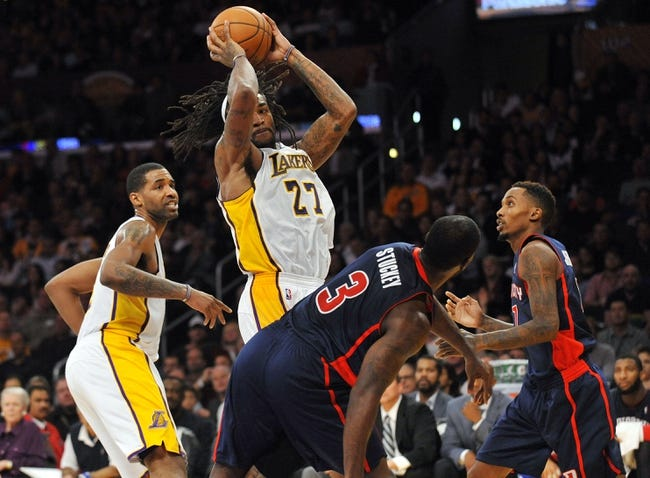 November 17, 2013; Los Angeles, CA, USA; Los Angeles Lakers center Jordan Hill (27) grabs a rebound against the defense of Detroit Pistons shooting guard Rodney Stuckey (3) during the second half at Staples Center. Mandatory Credit: Gary A. Vasquez-USA TODAY Sports