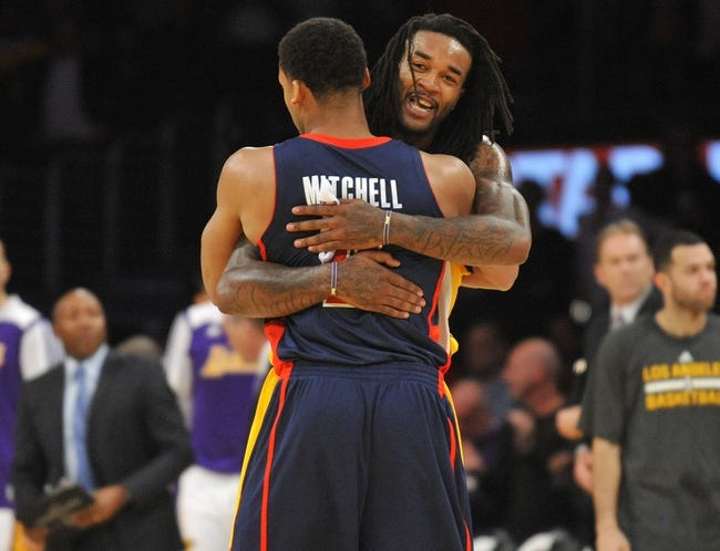 November 17, 2013; Los Angeles, CA, USA; Los Angeles Lakers center Jordan Hill (27) meets with power forward Tony Mitchell (9) following the 114-99 victory against the Detroit Pistons at Staples Center. Mandatory Credit: Gary A. Vasquez-USA TODAY Sports