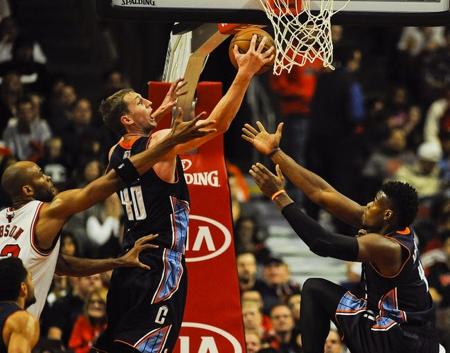 Nov 18, 2013; Chicago, IL, USA; Charlotte Bobcats center Cody Zeller (40) grabs a rebound with teammate power forward Jeff Adrien (4) during the first quarter of their game against the Chicago Bulls at the United Center. Mandatory Credit: Matt Marton-USA TODAY Sports