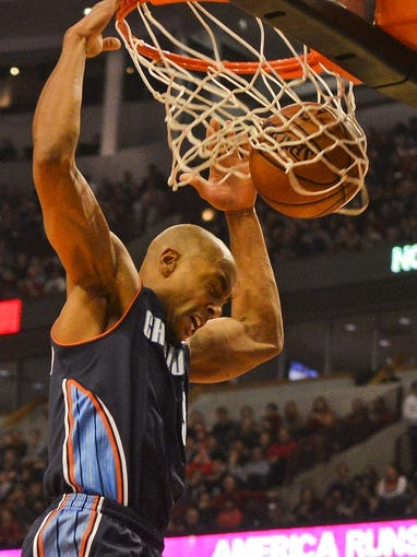 Nov 18, 2013; Chicago, IL, USA; Charlotte Bobcats shooting guard Gerald Henderson (9) dunks the ball during the second quarter of their game against the Chicago Bulls at the United Center. Mandatory Credit: Matt Marton-USA TODAY Sports