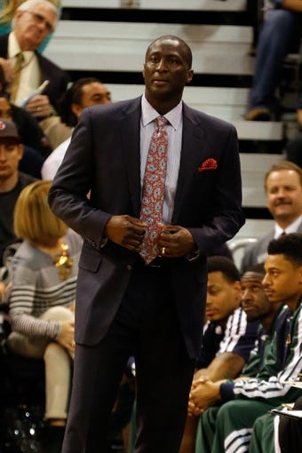 Nov 18, 2013; Salt Lake City, UT, USA; Utah Jazz head coach Tyrone Corbin watches the game during the first quarter between the Utah Jazz and the Golden State Warriors at EnergySolutions Arena. Mandatory Credit: Chris Nicoll-USA TODAY Sports