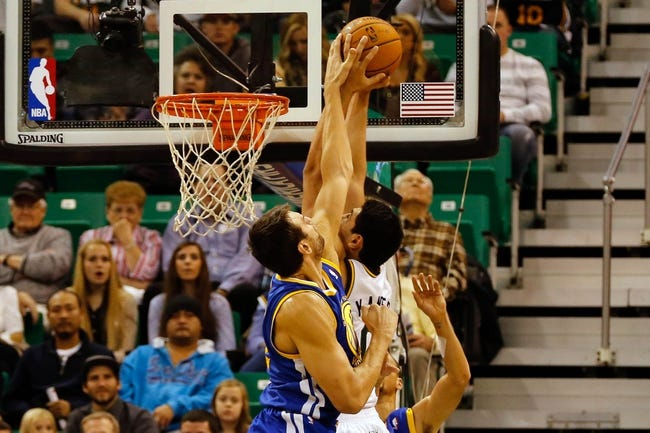 Nov 18, 2013; Salt Lake City, UT, USA; Golden State Warriors center Andrew Bogut (12) blocks the shot of Utah Jazz center Enes Kanter (0) during the first quarter at EnergySolutions Arena. Mandatory Credit: Chris Nicoll-USA TODAY Sports