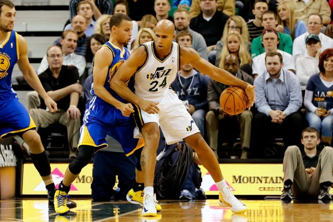 Nov 18, 2013; Salt Lake City, UT, USA; Utah Jazz small forward Richard Jefferson (24) dribbles the ball as Golden State Warriors point guard Stephen Curry (30) defends during the second quarter at EnergySolutions Arena. Mandatory Credit: Chris Nicoll-USA TODAY Sports