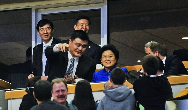 Nov 18, 2013; Chicago, IL, USA;  Chinese former pro basketball player Yao Ming (left) talks with Second-ranked vice premier peoples republic of China Liu Yandong during the Charlotte Bobcats and Chicago Bulls game at the United Center. Mandatory Credit: Matt Marton-USA TODAY Sports