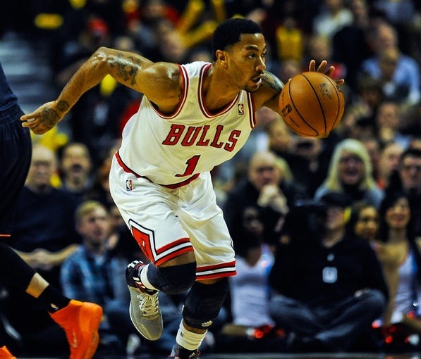 Nov 18, 2013; Chicago, IL, USA; Chicago Bulls point guard Derrick Rose (1) drives with the ball during the second quarter against the Charlotte Bobcats at the United Center. Mandatory Credit: Matt Marton-USA TODAY Sports