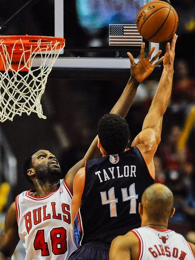 Nov 18, 2013; Chicago, IL, USA; Chicago Bulls center Nazr Mohammed (48) blocks Charlotte Bobcats shooting guard Jeff Taylor (44) during the second half of their game at the United Center. The Bulls won 86-81. Mandatory Credit: Matt Marton-USA TODAY Sports