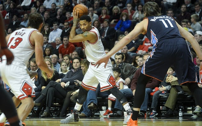 Nov 18, 2013; Chicago, IL, USA; Chicago Bulls point guard Derrick Rose (1) holds the ball against the Charlotte Bobcats during the second half at the United Center. The Bulls won 86-81. Mandatory Credit: Matt Marton-USA TODAY Sports