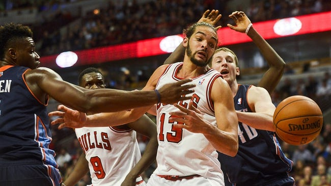 Nov 18, 2013; Chicago, IL, USA; Chicago Bulls small forward Luol Deng (9) and Chicago Bulls center Joakim Noah (13) look after a loose ball againstCharlotte Bobcats power forward Jeff Adrien (4) and Charlotte Bobcats center Cody Zeller (40)during the second half of their game at the United Center. The Bulls won 86-81. Mandatory Credit: Matt Marton-USA TODAY Sports