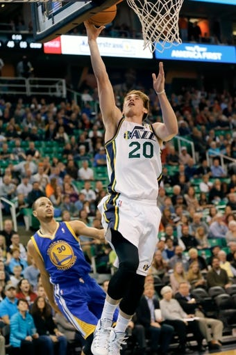Nov 18, 2013; Salt Lake City, UT, USA; Utah Jazz shooting guard Gordon Hayward (20) lays the ball into the basket during the third quarter against the Golden State Warriors at EnergySolutions Arena. Golden State Warriors won 98-87. Mandatory Credit: Chris Nicoll-USA TODAY Sports