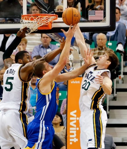 Nov 18, 2013; Salt Lake City, UT, USA; Golden State Warriors power forward David Lee (10) is fouled by Utah Jazz shooting guard Gordon Hayward (20) while shooting the ball during the third quarter at EnergySolutions Arena. Golden State Warriors won 98-87. Mandatory Credit: Chris Nicoll-USA TODAY Sports