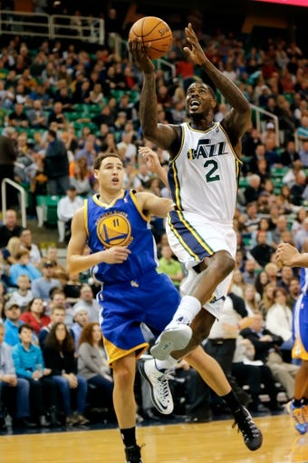 Nov 18, 2013; Salt Lake City, UT, USA; Utah Jazz power forward Marvin Williams (2) drives to the basket while Golden State Warriors shooting guard Klay Thompson (11) gets out of the way during the third quarter at EnergySolutions Arena. Golden State Warriors won 98-87. Mandatory Credit: Chris Nicoll-USA TODAY Sports