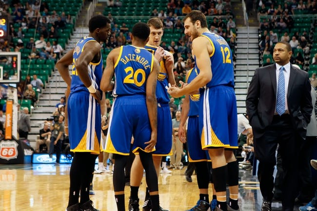 Nov 18, 2013; Salt Lake City, UT, USA; Golden State Warriors center Andrew Bogut (12) encourages shooting guard Kent Bazemore (20), center Ognjen Kuzmic (1), forward Dewayne Dedmon (21) and point guard Nemanja Nedovic (8) to play harder against the Utah Jazz during the fourth quarter at EnergySolutions Arena. Golden State Warriors won 98-87. Mandatory Credit: Chris Nicoll-USA TODAY Sports