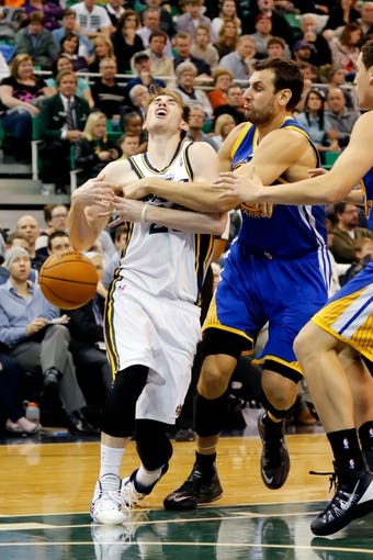Nov 18, 2013; Salt Lake City, UT, USA; Utah Jazz shooting guard Gordon Hayward (20) is fouled by Golden State Warriors center Andrew Bogut (12) while driving to the basket during the fourth quarter at EnergySolutions Arena. Golden State Warriors won 98-87. Mandatory Credit: Chris Nicoll-USA TODAY Sports