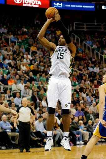 Nov 18, 2013; Salt Lake City, UT, USA; Utah Jazz power forward Derrick Favors (15) takes a jump shoot from the foul line during the fourth quarter against the Golden State Warriors at EnergySolutions Arena. Golden State Warriors won 98-87. Mandatory Credit: Chris Nicoll-USA TODAY Sports