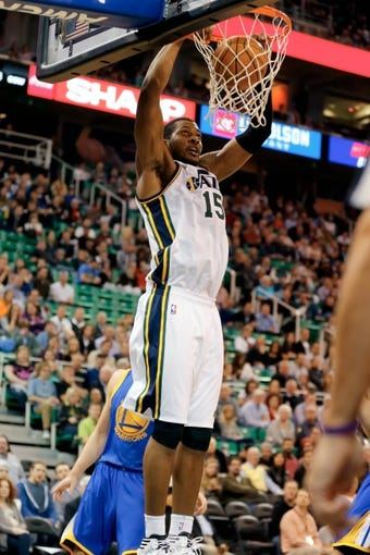 Nov 18, 2013; Salt Lake City, UT, USA; Utah Jazz power forward Derrick Favors (15) dunks the ball into the basket in the third quarter against the Golden State Warriors at EnergySolutions Arena. Golden State Warriors won 98-87. Mandatory Credit: Chris Nicoll-USA TODAY Sports
