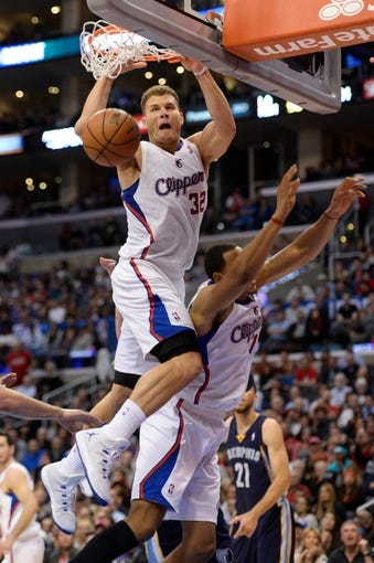 Nov 18, 2013; Los Angeles, CA, USA; Los Angeles Clippers power forward Blake Griffin (32) dunks off of a missed shot over over teammate Ryan Hollins (right) during second half action at Staples Center. The Grizzlies went on to a 106-102 win. Griffin had 23 points in the game. Mandatory Credit: Robert Hanashiro-USA TODAY Sports