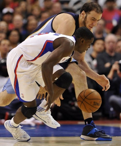 Nov 18, 2013; Los Angeles, CA, USA; Los Angeles Clippers point guard Darren Collison (2) and Memphis Grizzlies center Kosta Koufos (41) chase down a loose ball during the third quarter at Staples Center. The Grizzlies went on to a 106-102 win. Mandatory Credit: Robert Hanashiro-USA TODAY Sports