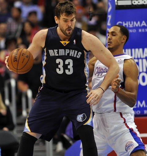 Nov 18, 2013; Los Angeles, CA, USA; Memphis Grizzlies center Marc Gasol (33) drives thew baseline on Los Angeles Clippers forward Ryan Hollins during second half action at Staples Center. Mandatory Credit: Robert Hanashiro-USA TODAY Sports