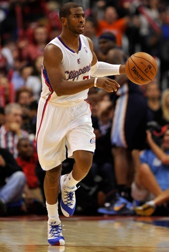 Nov 18, 2013; Los Angeles, CA, USA; Los Angeles Clippers point guard Chris Paul (3) brings the ball down court during the second half against the Memphis Grizzlies at Staples Center. Mandatory Credit: Robert Hanashiro-USA TODAY Sports