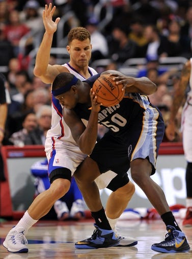 Nov 18, 2013; Los Angeles, CA, USA; Memphis Grizzlies power forward Zach Randolph (50) tries to drive to the basket on Los Angeles Clippers power forward Blake Griffin (32) during second half action at Staples Center. Mandatory Credit: Robert Hanashiro-USA TODAY Sports