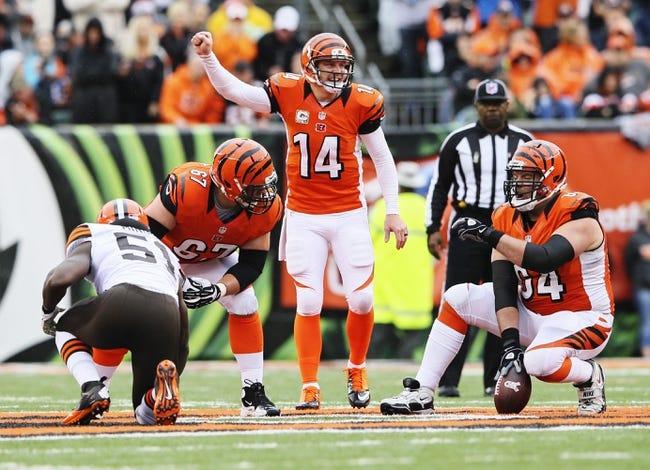 Nov 17, 2013; Cincinnati, OH, USA; Cincinnati Bengals quarterback Andy Dalton (14) calls signals during the game against the Cleveland Browns at Paul Brown Stadium. Cincinnati won 41-20.  Mandatory Credit: Kevin Jairaj-USA TODAY Sports