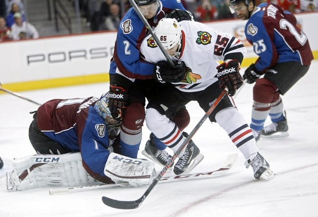 Nov 19, 2013; Denver, CO, USA; Colorado Avalanche goalie Semyon Varlamov (1) stops the puck in front of defenseman Nick Holden (2) and Chicago Blackhawks center Andrew Shaw (65) during the third period at Pepsi Center. The Avalanche won 5-1. Mandatory Credit: Chris Humphreys-USA TODAY Sports