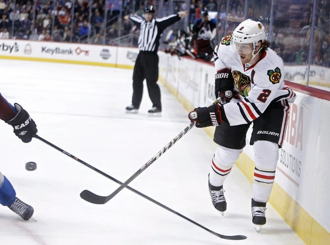 Nov 19, 2013; Denver, CO, USA; Chicago Blackhawks defenseman Duncan Keith (2) passes the puck during the third period against the Colorado Avalanche at Pepsi Center. The Avalanche won 5-1. Mandatory Credit: Chris Humphreys-USA TODAY Sports