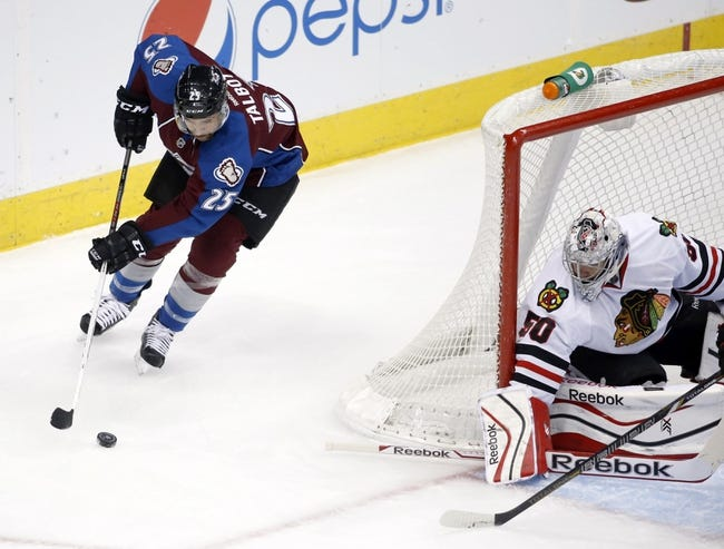 Nov 19, 2013; Denver, CO, USA; Colorado Avalanche center Maxime Talbot (25) prepares to shoot the puck against Chicago Blackhawks goalie Corey Crawford (50) during the first period at Pepsi Center. Mandatory Credit: Chris Humphreys-USA TODAY Sports