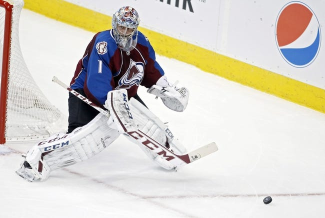 Nov 19, 2013; Denver, CO, USA; Colorado Avalanche goalie Semyon Varlamov (1) deflects a shot during the first period against the Chicago Blackhawks at Pepsi Center. Mandatory Credit: Chris Humphreys-USA TODAY Sports
