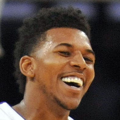 November 17, 2013; Los Angeles, CA, USA; Los Angeles Lakers small forward Nick Young (0) reacts during the game against the Detroit Pistons during the second half at Staples Center. Mandatory Credit: Gary A. Vasquez-USA TODAY Sports