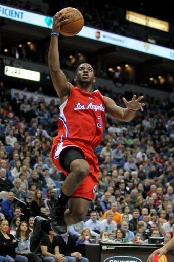Nov 20, 2013; Minneapolis, MN, USA; Los Angeles Clippers guard Chris Paul (3) shoots during the second quarter against the Minnesota Timberwolves at Target Center. Mandatory Credit: Brace Hemmelgarn-USA TODAY Sports