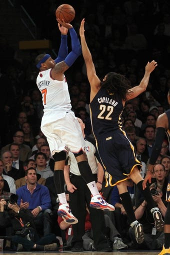 Nov 20, 2013; New York, NY, USA; New York Knicks small forward Carmelo Anthony (7) shoots over Indiana Pacers small forward Chris Copeland (22) during the fourth quarter at Madison Square Garden. The Pacers defeated the Knicks 103-96 in overtime. Mandatory Credit: Brad Penner-USA TODAY Sports