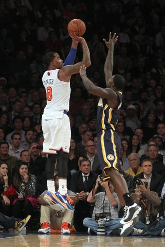 Nov 20, 2013; New York, NY, USA; New York Knicks shooting guard J.R. Smith (8) shoots over Indiana Pacers shooting guard Lance Stephenson (1) during the fourth quarter at Madison Square Garden. The Pacers defeated the Knicks 103-96 in overtime. Mandatory Credit: Brad Penner-USA TODAY Sports