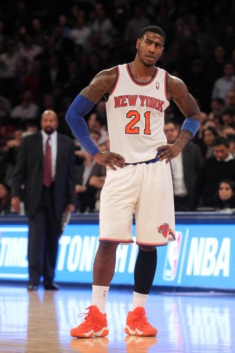 Nov 20, 2013; New York, NY, USA; New York Knicks shooting guard Iman Shumpert (21) reacts to a foul call late during the fourth quarter of a game against the Indiana Pacers at Madison Square Garden. The Pacers defeated the Knicks 103-96 in overtime. Mandatory Credit: Brad Penner-USA TODAY Sports