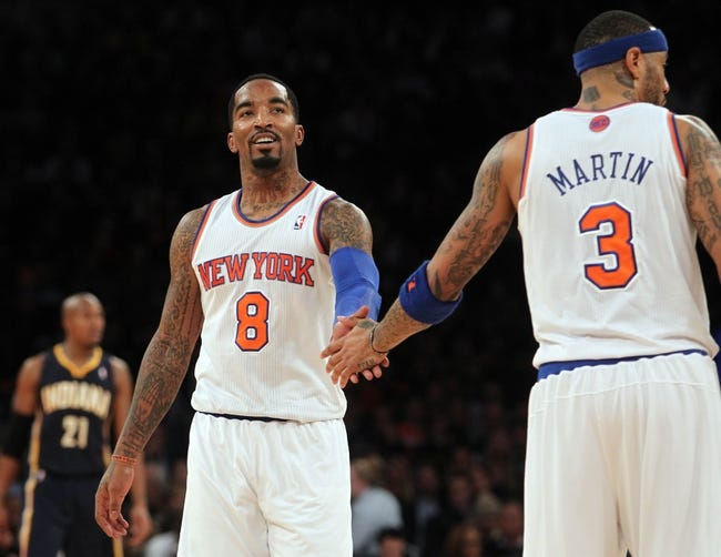 Nov 20, 2013; New York, NY, USA; New York Knicks shooting guard J.R. Smith (8) reacts with New York Knicks power forward Kenyon Martin (3) against the Indiana Pacers during the third quarter at Madison Square Garden. The Pacers defeated the Knicks 103-96 in overtime. Mandatory Credit: Brad Penner-USA TODAY Sports